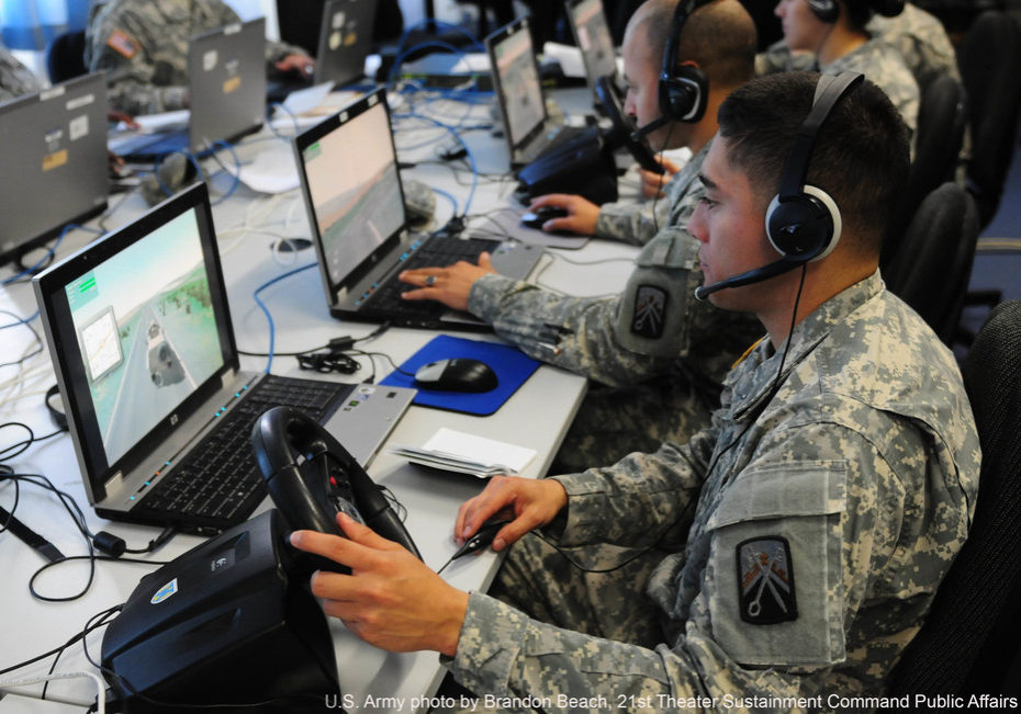 Spc. Fernando Gomez operates a computer-based simulation during a recent exercise facilitated by the 7th Army's Joint Multinational Simulations Center at Grafenwoehr, Germany. (PRNewsfoto/Tapestry Solutions, Inc.)